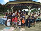 children gathered at gazebo