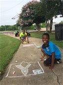 children with chalk art designs